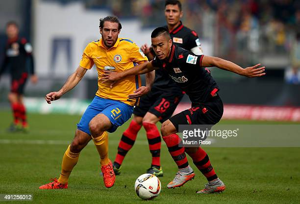 Patrick Schoenfeld of Braunschweig challenges for the ball with Bobby Wood of Union Berlin during the Second Bundesliga match between Eintracht...