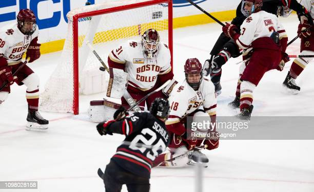 Patrick Schule of the Northeastern Huskies scores a goal against Joseph Woll of the Boston College Eagles during NCAA hockey in the championship game...