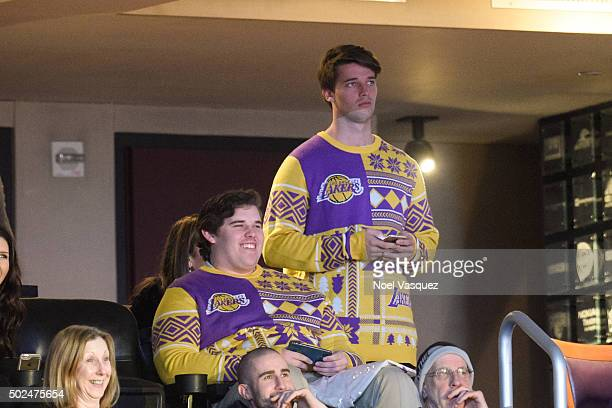 Patrick Schwarzenegger and Christopher Schwarzenegger attend a basketball game between the Los Angeles Clippers and the Los Angeles Lakers at Staples...