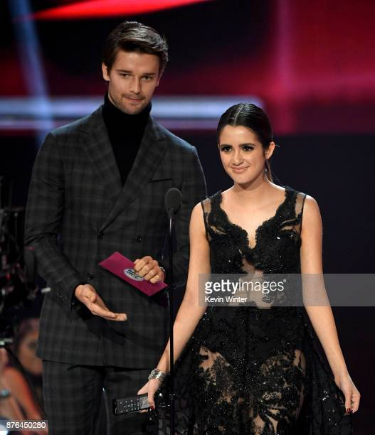 Patrick Schwarzenegger and Laura Marano speak onstage during the 2017 American Music Awards at Microsoft Theater on November 19 2017 in Los Angeles...