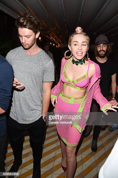 Patrick Schwarzenegger and Miley Cyrus attend Jeremy Scott Moschino Party with Barbie on December 4 2014 in Miami Beach Florida