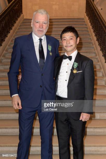 Patrick Seguin poses with Yusaku Maezawa during Yusaku Maezawa Patrick Seguin Awarded Chevalier Des Arts et Lettres on March 6 2018 in Paris France