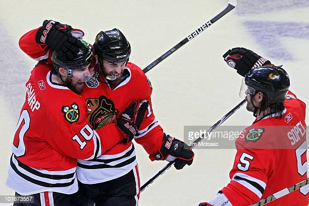 Patrick Sharp Andrew Ladd and Brent Sopel of the Chicago Blackhawks celebrate after defeating the Philadelphia Flyers 74 in Game Five of the 2010 NHL...