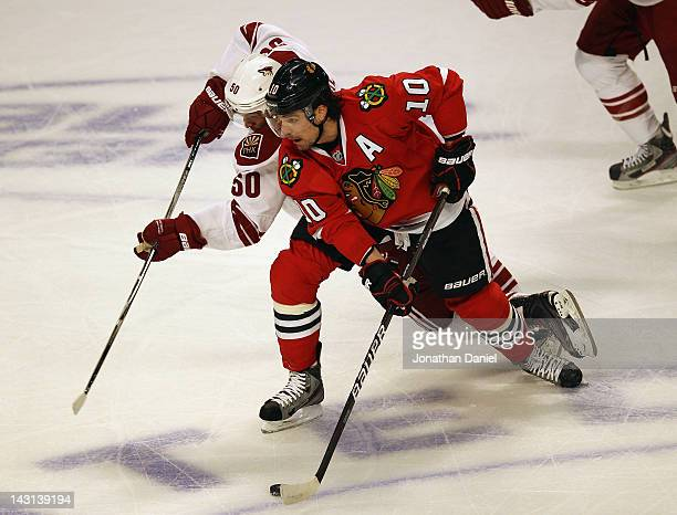 Patrick Sharp of the Chicago Blackhawks brings the puck up the ice under pressure from Antoniue Vermette of the Phoenix Coyotes in Game Four of the...