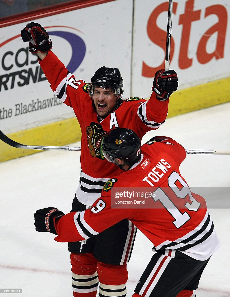 Patrick Sharp #10 of the Chicago Blackhawks celebrates his first period goal with teammate Jonathan Toews #19 against the Calgary Flames during Game Five of the Western Conference Quarterfinals of the 2009 Stanley Cup Playoffs on April 25, 2009 at the United Center in Chicago, Illinois.