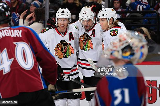 Patrick Sharp of the Chicago Blackhawks celebrates his goal against goalie Calvin Pickard of the Colorado Avalanche with teammates Duncan Keith and...