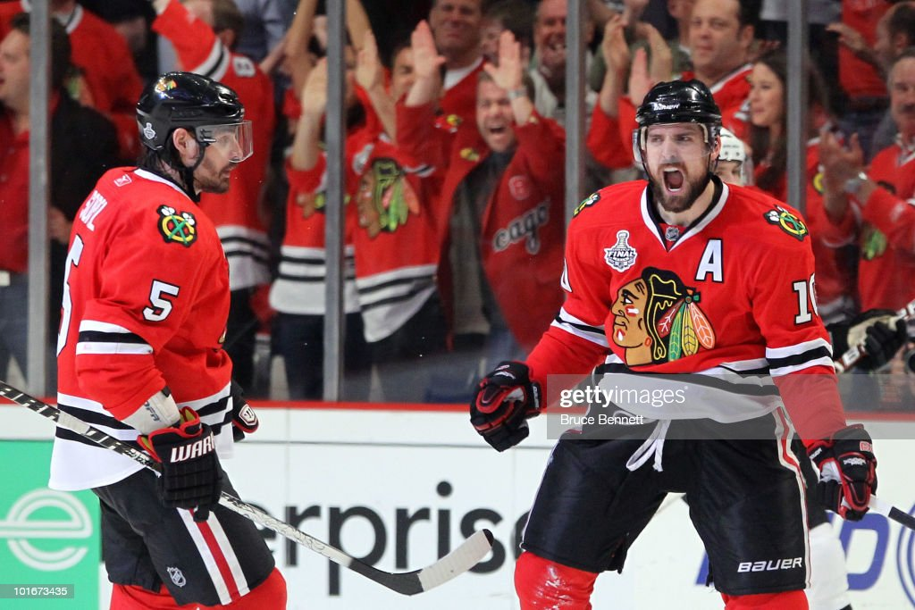 Patrick Sharp #10 of the Chicago Blackhawks celebrates with teammate Brent Sopel #5 after scoring a goal in the third period against the Philadelphia Flyers in Game Five of the 2010 NHL Stanley Cup Final at the United Center on June 6, 2010 in Chicago, Illinois.