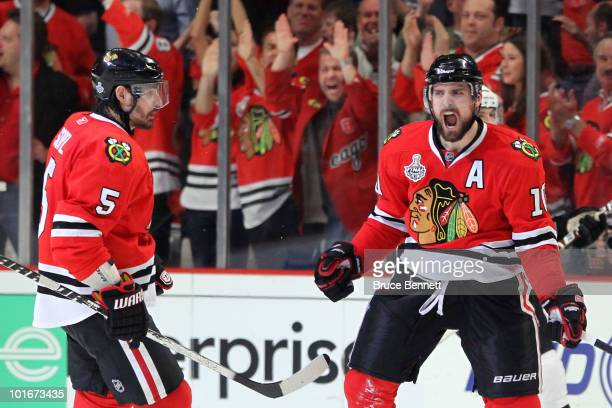 Patrick Sharp of the Chicago Blackhawks celebrates with teammate Brent Sopel after scoring a goal in the third period against the Philadelphia Flyers...