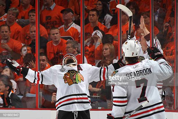 Patrick Sharp of the Chicago Blackhawks celebrates with teammate Brent Seabrook after scoring a goal in the second period against the Philadelphia...