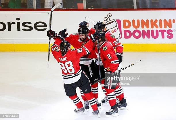 Patrick Sharp of the Chicago Blackhawks celebrates with teammates after scoring a goal in the first period against Tuukka Rask of the Boston Bruins...