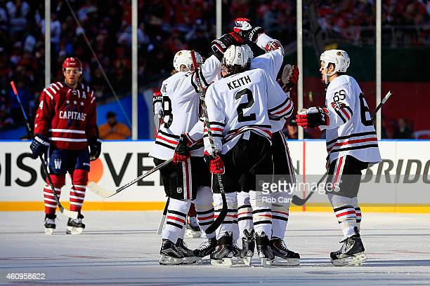 Patrick Sharp of the Chicago Blackhawks celebrates with teammates after scoring a first period goal against the Washington Capitals in the 2015 NHL...