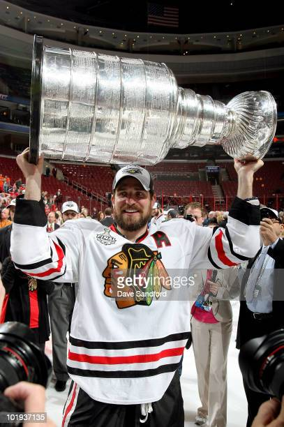 Patrick Sharp of the Chicago Blackhawks celebrates with the Stanley Cup after the Blackhawks defeated the Philadelphia Flyers 43 in overtime and win...