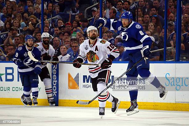 Patrick Sharp of the Chicago Blackhawks collides with Anton Stralman of the Tampa Bay Lightning during Game Five of the 2015 NHL Stanley Cup Final at...