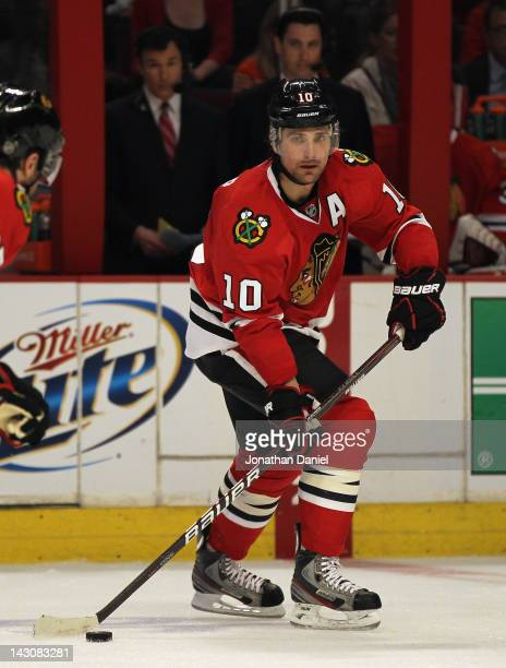 Patrick Sharp of the Chicago Blackhawks controls the puck against the Phoenix Coyotes in Game Three of the Western Conference Quarterfinals during...