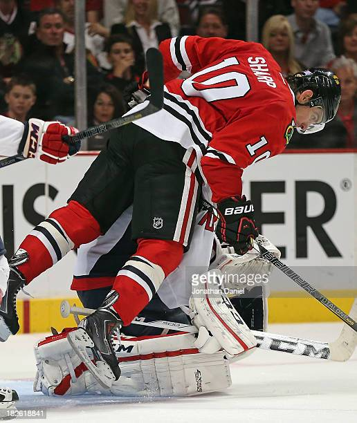 Patrick Sharp of the Chicago Blackhawks falls over Braden Holtby of the Washington Capitals and is called for goaltender interference at the United...