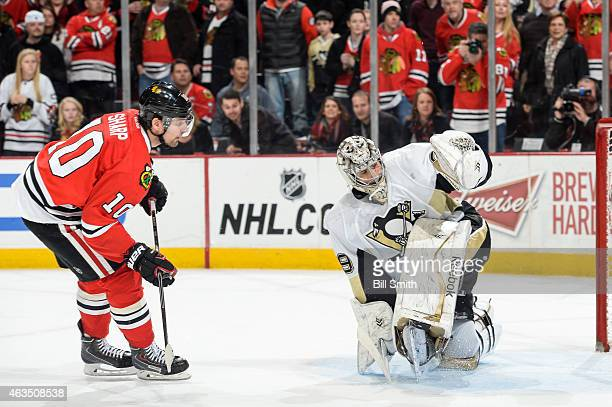 Patrick Sharp of the Chicago Blackhawks gets the puck past goalie MarcAndre Fleury of the Pittsburgh Penguins in the shootout to win the game 21...