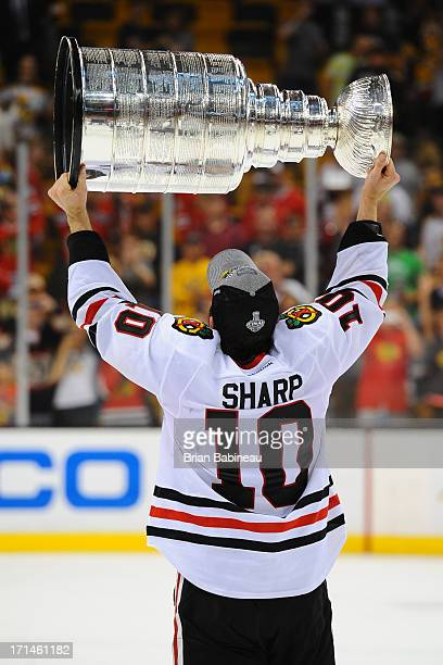Patrick Sharp of the Chicago Blackhawks hoists the Stanley Cup after the win against the Boston Bruins in Game Six of the Stanley Cup Final at TD...