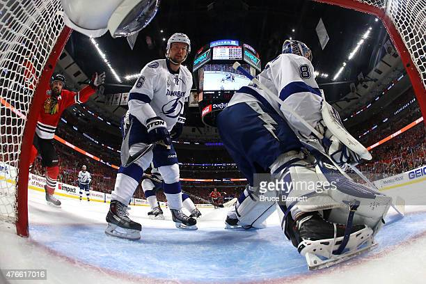 Patrick Sharp of the Chicago Blackhawks reacts after a goal by Jonathan Toews on Andrei Vasilevskiy of the Tampa Bay Lightning during Game Four of...