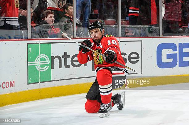 Patrick Sharp of the Chicago Blackhawks reacts after scoring the game winning goal in overtime against the Dallas Stars during the NHL game at the...