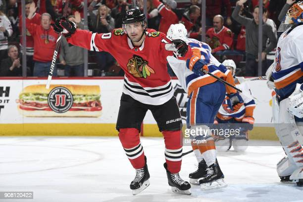 Patrick Sharp of the Chicago Blackhawks reacts after the Blackhawks scored against the New York Islanders in the third period at the United Center on...