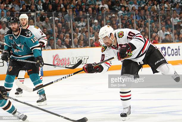 Patrick Sharp of the Chicago Blackhawks scores a goal against Patrick Marleau and the San Jose Sharks in Game One of the Western Conference Finals...