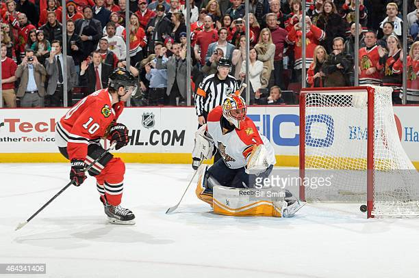 Patrick Sharp of the Chicago Blackhawks scores on the shootout against Roberto Luongo of the Florida Panthers during the NHL game at the United...