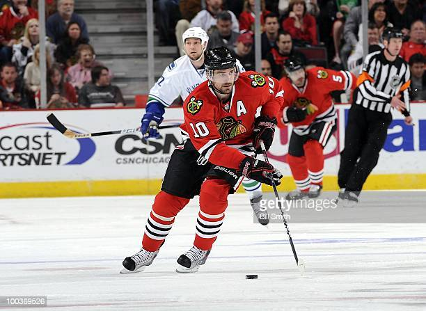 Patrick Sharp of the Chicago Blackhawks takes control of the puck at Game Five of the Western Conference Semifinals against the Vancouver Canucks...