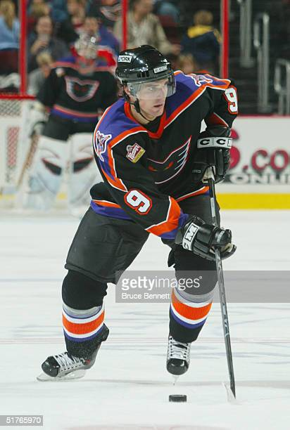 Patrick Sharp of the Philadelphia Phantoms skates the puck through the neutral zone against the Hamilton Bulldogs during the American Hockey League...