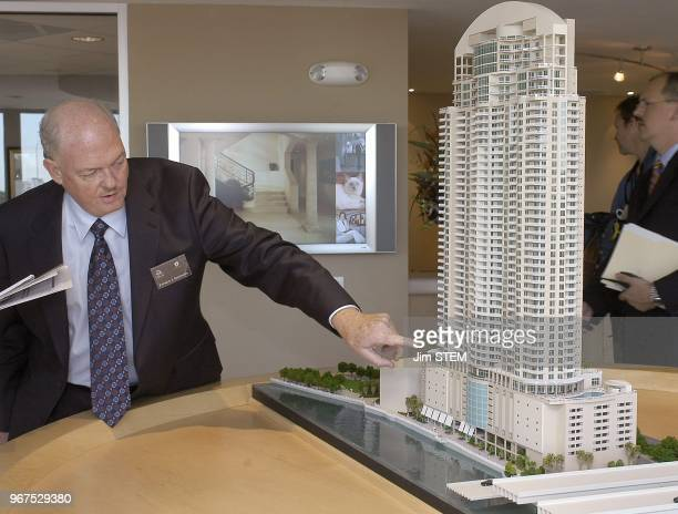 Patrick Sheppard one of the principals of SimDag/RoBEL LLC shows off the Trump Tower Tampa model in the sales office Friday afternoon Donald Trump...