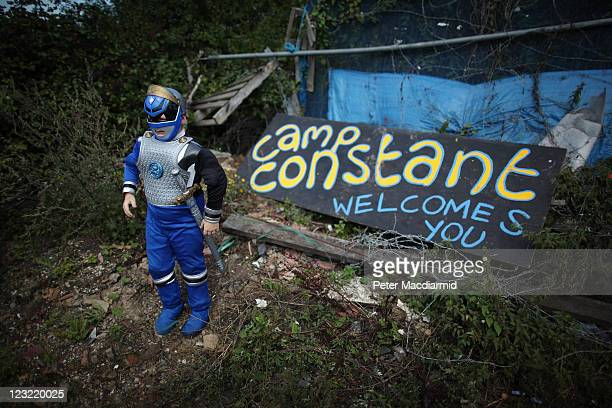 Patrick Sheridan aged seven poses for a photograph in a Power Rangers' outfit at the entrance to Camp Constant at Dale Farm travellers camp on...
