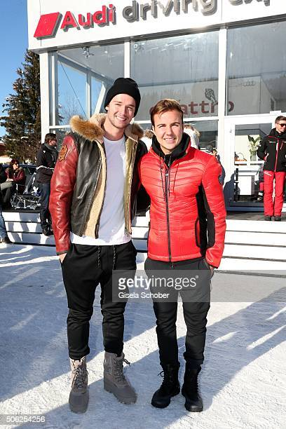 Patrick Shriver Schwarzenegger and soccer player Mario Goetze attend the Audi driving experience during the Audi Hahnenkamm race weekend on January...