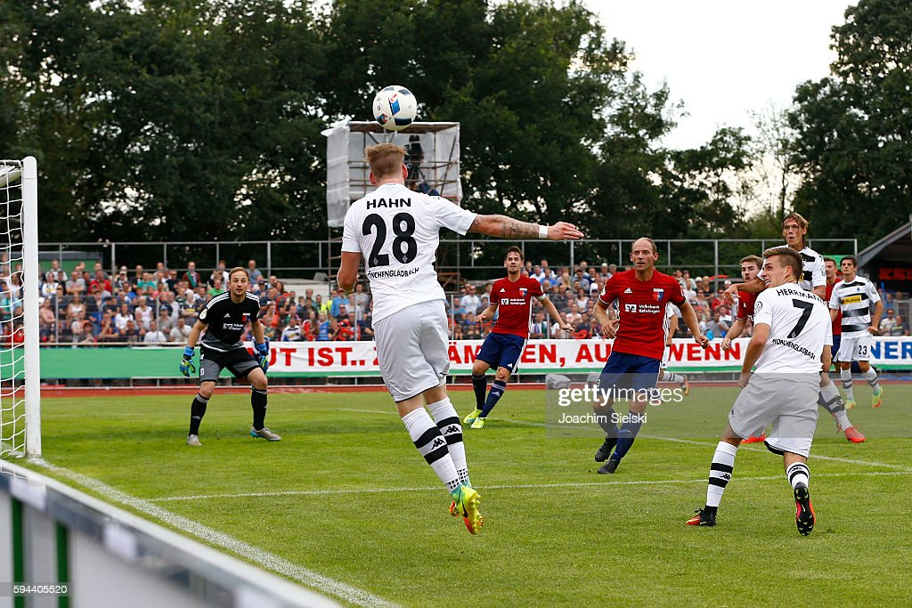 Patrick Siefkes, Soeren Behrmann and Meikel Klee of Drochtersen challenges Andre Hahn, Patrick Herrmann and Jannik Vestergaard of Moenchengladbach during the DFB Cup match between SV Drochtersen/Assel and Borussia Moenchengladbach at Kehdinger Stadion on August 20, 2016 in Drochtersen, Germany.