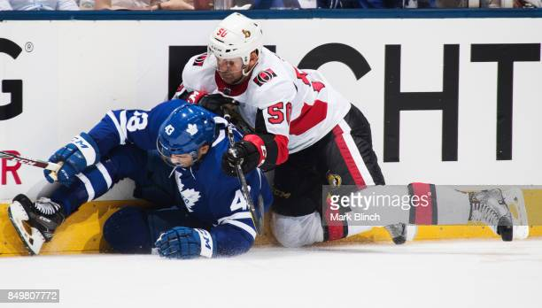Patrick Sieloff of the Ottawa Senators checks Nazem Kadri of the Toronto Maple Leafs during the third period at the Air Canada Centre in their...