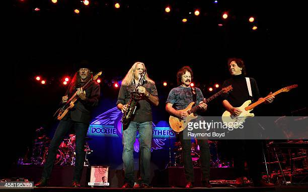 Patrick Simmons Marc Russo Tom Johnston and John McFee of the Doobie Brothers performs on the Briggs Stratton Big Backyard Stage at the Henry W Maier...