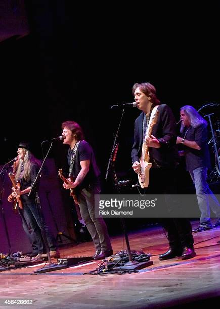 Patrick Simmons Tom Johnston and John McFee of The Doobie Brothers perform onstage at the Honors Awards Ceremony during Day 4 of the IEBA 2014...