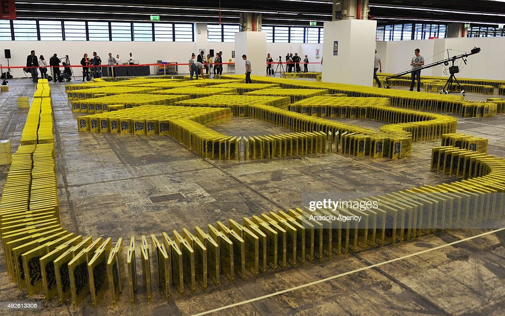 Patrick Sinner and his team break the new book-domino world record during the 2015 Frankfurt Book Fair, in Frankfurt am Main, Germany, 14 October 2015. Some 10,200 toppling editions of the Guinness Book of World Records set a new world record.