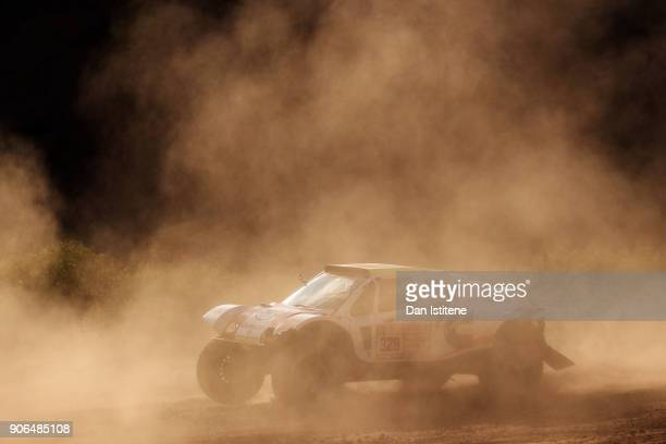 Patrick Sireyjol of France and Cummins France drives with codriver FrancoisXavier Beguin of Belgium in the LCR30 Buggy Car in the Classe T13 2 Roues...