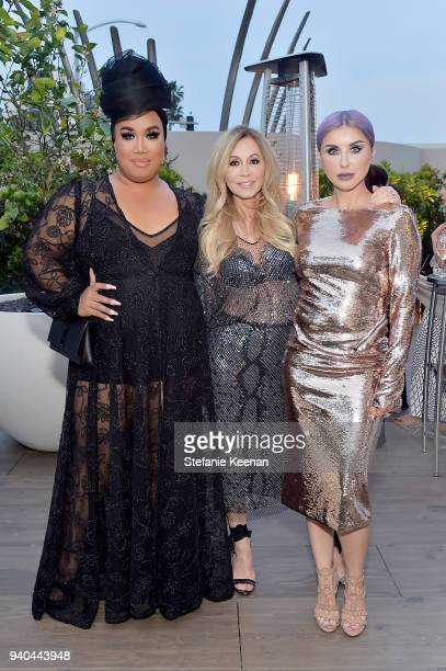 Patrick Starr Anastasia Soare and Claudia Soare attends KKWxMario Dinner at JeanGeorges Beverly Hills on March 31 2018 in Beverly Hills California