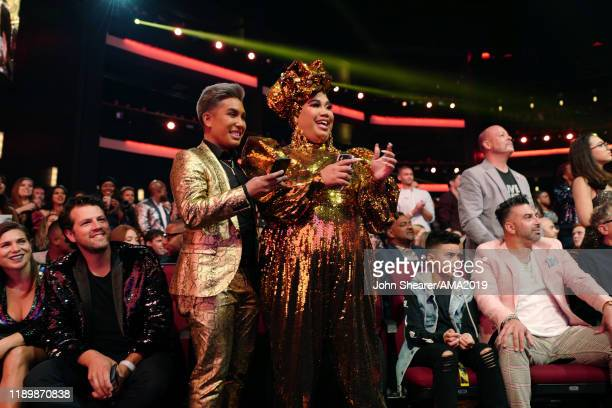 Patrick Starrr and guest attend the 2019 American Music Awards at Microsoft Theater on November 24 2019 in Los Angeles California