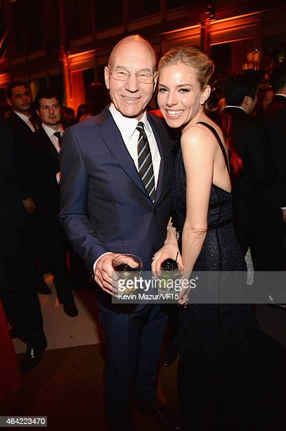 Patrick Stewart and Sienna Miller attend the 2015 Vanity Fair Oscar Party hosted by Graydon Carter at the Wallis Annenberg Center for the Performing...