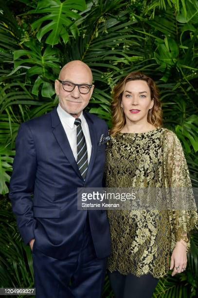 Patrick Stewart and Sunny Ozell attend CHANEL and Charles Finch Pre-Oscar Awards Dinner at Polo Lounge at The Beverly Hills Hotel on February 08,...