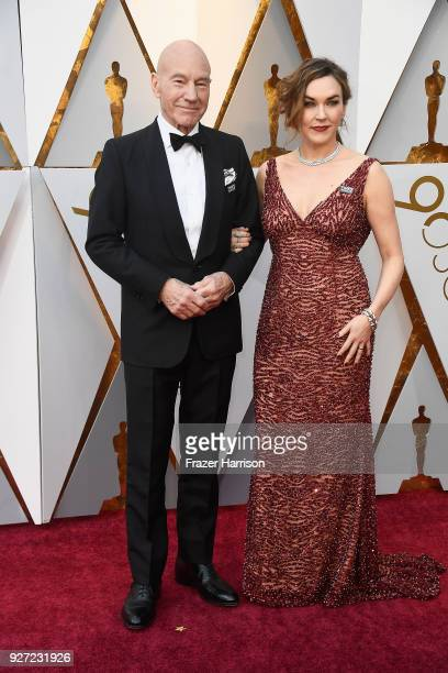 Patrick Stewart and Sunny Ozell attend the 90th Annual Academy Awards at Hollywood Highland Center on March 4 2018 in Hollywood California