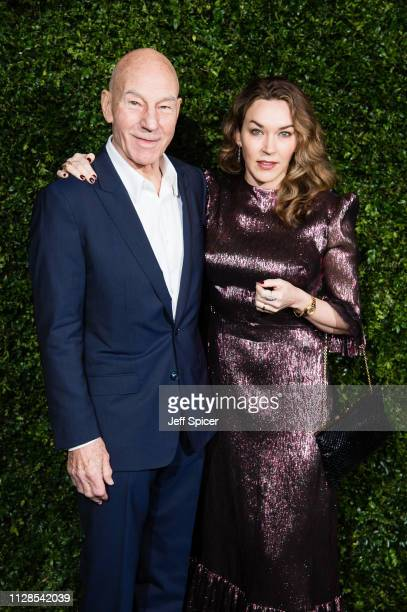 Patrick Stewart and Sunny Ozell attend the Charles Finch Chanel preBAFTA's dinner at Loulou's on February 09 2019 in London England