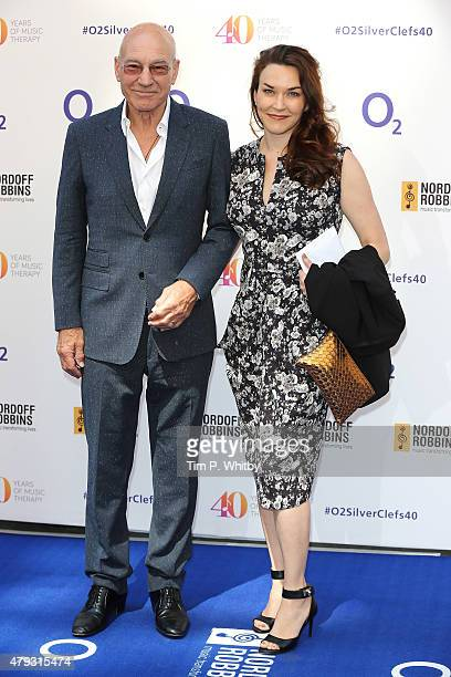 Patrick Stewart and Sunny Ozell attend the Nordoff Robbins 02 Silver clef Awards at The Grosvenor House Hotel on July 3 2015 in London England