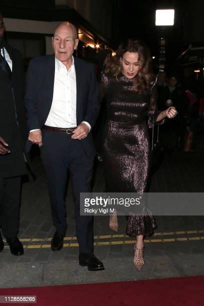Patrick Stewart and Sunny Ozell seen attending the Charles Finch PreBAFTA Party at Loulou's on February 09 2019 in London England