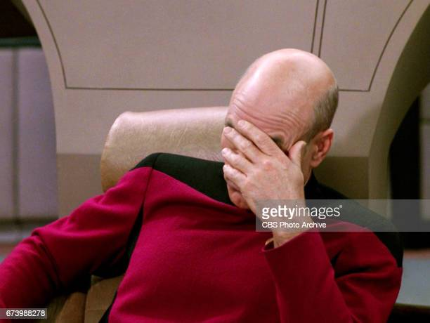 Patrick Stewart as Captain JeanLuc Picard Picard holding his face in his hand in the Star Trek The Next Generation episode Deja Q In the episode...