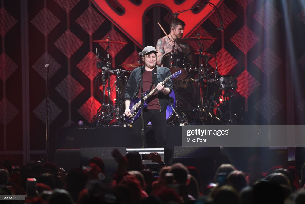 Patrick Stump and Andy Hurley of Fall Out Boy perform onstage during Q102's Jingle Ball 2017 Presented by Capital One at Wells Fargo Center on December 6, 2017 in Philadelphia, Pennsylvania.