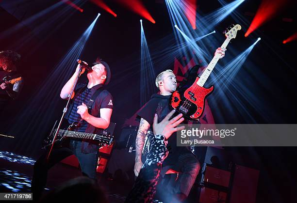 Patrick Stump and Pete Wentz of Fall Out Boy perform at the 2015 AE Networks Upfront on April 30 2015 in New York City