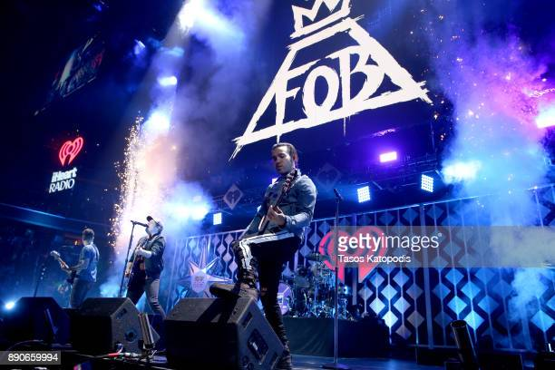 Patrick Stump and Pete Wentz of Fall Out Boy perform onstage during Hot 995's Jingle Ball 2017 Presented by Capital One at Capital One Arena on...