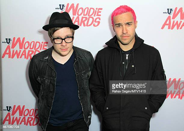 Patrick Stump and Pete Wentz of Fall out Boy pose backstage at the 2015 MTV Woodies Festival on March 20 2015 in Austin Texas